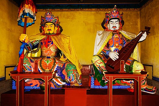 Two statues in a temple, Da Zhao Temple, Hohhot, Inner Mongolia, China : Stock Photo