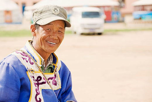 Close-up of a mature man smiling, Inner Mongolia, China : Stock Photo