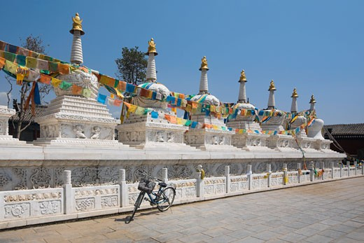 Stock Photo: 1768R-14121 Bicycle in front of a temple, Hohhot, Inner Mongolia, China