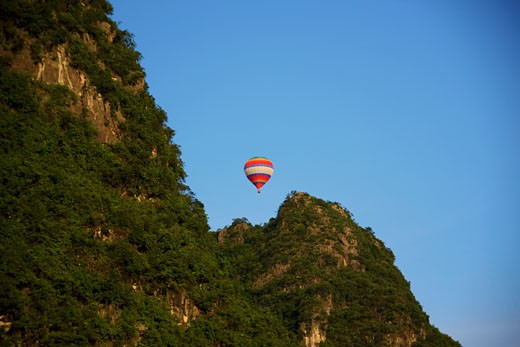 Stock Photo: 1768R-14157 Low angle view of a hot air balloon, Yangshuo, Guangxi Province, China
