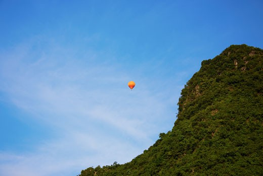 Low angle view of a hot air balloon, Yangshuo, Guangxi Province, China : Stock Photo