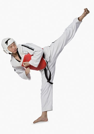 Stock Photo: 1768R-14514 Mid adult man practicing kickboxing