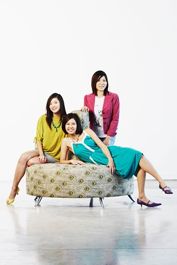 Portrait of three young women posing : Stock Photo