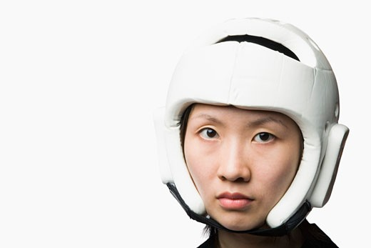 Portrait of a young woman wearing a sports helmet : Stock Photo
