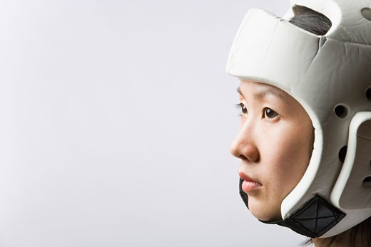 Stock Photo: 1768R-14534 Close-up of a young woman wearing a sports helmet