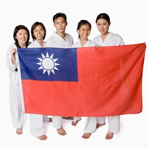 Stock Photo: 1768R-14594 Portrait of four young women and a young man holding a Taiwanese flag