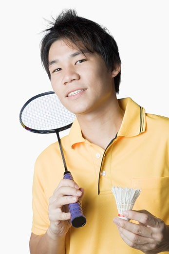 Stock Photo: 1768R-14640 Portrait of a young man holding a badminton racket and a shuttlecock