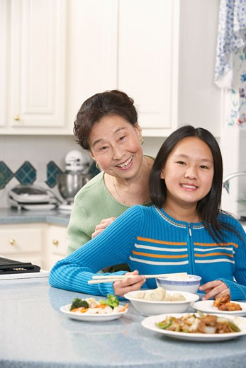 Portrait of a girl and her grandmother : Stock Photo
