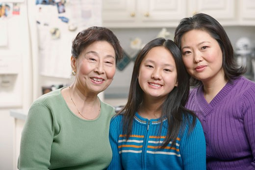 Stock Photo: 1768R-1709 Portrait of a girl smiling with her mother and grandmother