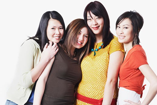 Stock Photo: 1768R-2277 Portrait of four young women smiling