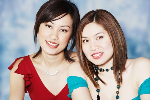 Portrait of two young women smiling : Stock Photo