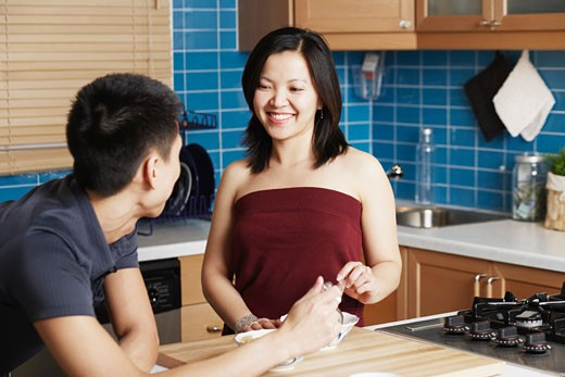 Close-up of a young couple in the kitchen : Stock Photo