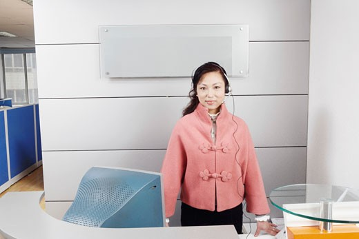 Stock Photo: 1768R-3505 Portrait of a customer service representative standing in an office