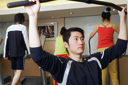 Stock Photo: 1768R-4778 Four people exercising in a gym