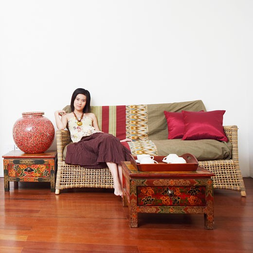 Stock Photo: 1768R-5261 Portrait of a young woman sitting on a couch