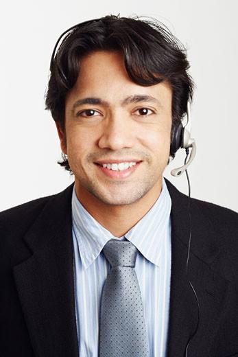 Stock Photo: 1768R-5837 Portrait of a male customer service representative smiling