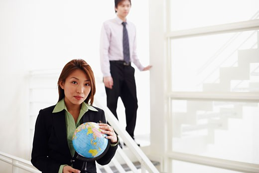 Stock Photo: 1768R-5972 Portrait of a businesswoman holding a globe