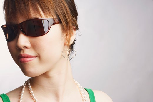 Close-up of a young woman wearing sunglasses : Stock Photo