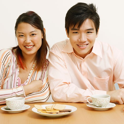 Stock Photo: 1768R-6998 Portrait of a young couple sitting together and smiling