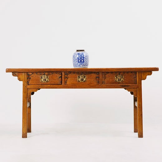 Stock Photo: 1768R-7157 Decorative urn on a wooden desk