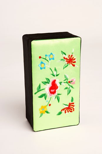 Close-up of flowers embroidered on a box : Stock Photo