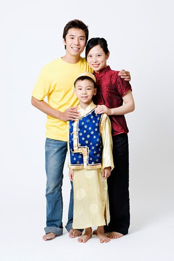 Portrait of a boy standing with his parents : Stock Photo