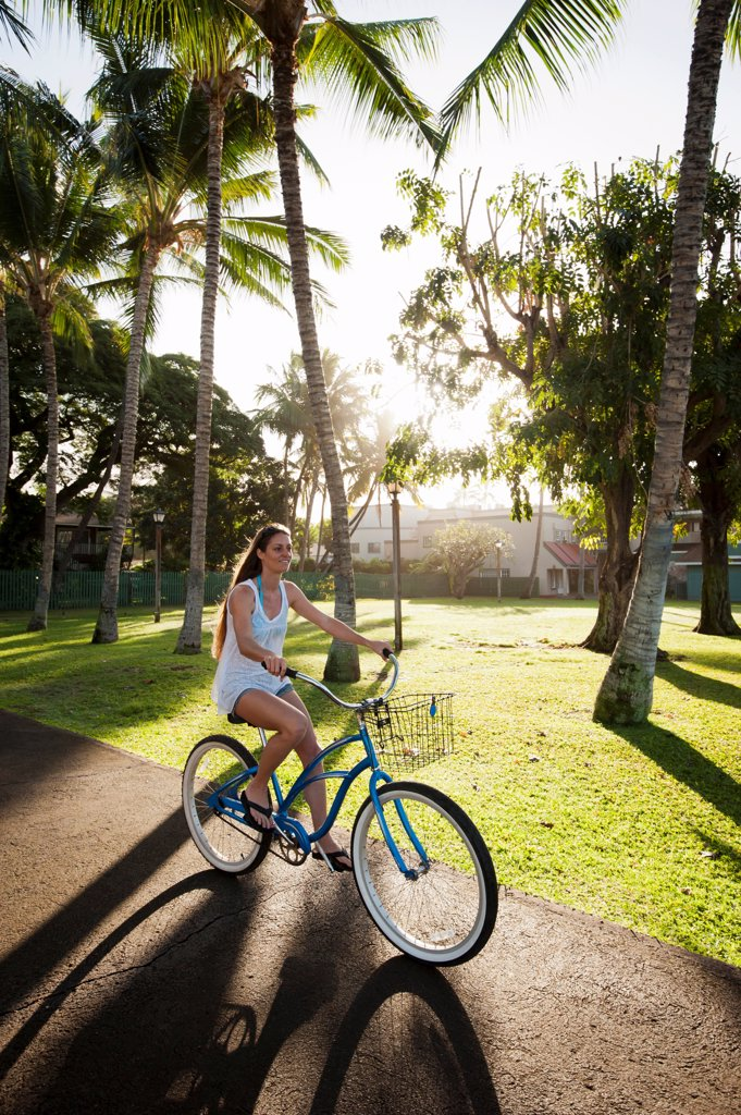 Woman riding bicycle in park : Stock Photo