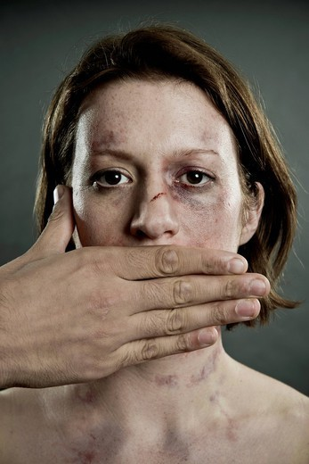 Woman with bruises and mouth covered : Stock Photo