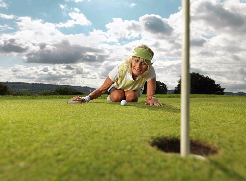 Stock Photo: 1773-19858 Mature lady playing golf