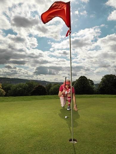 Mature lady playing golf : Stock Photo