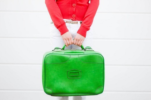 Girl holding suitcase : Stock Photo