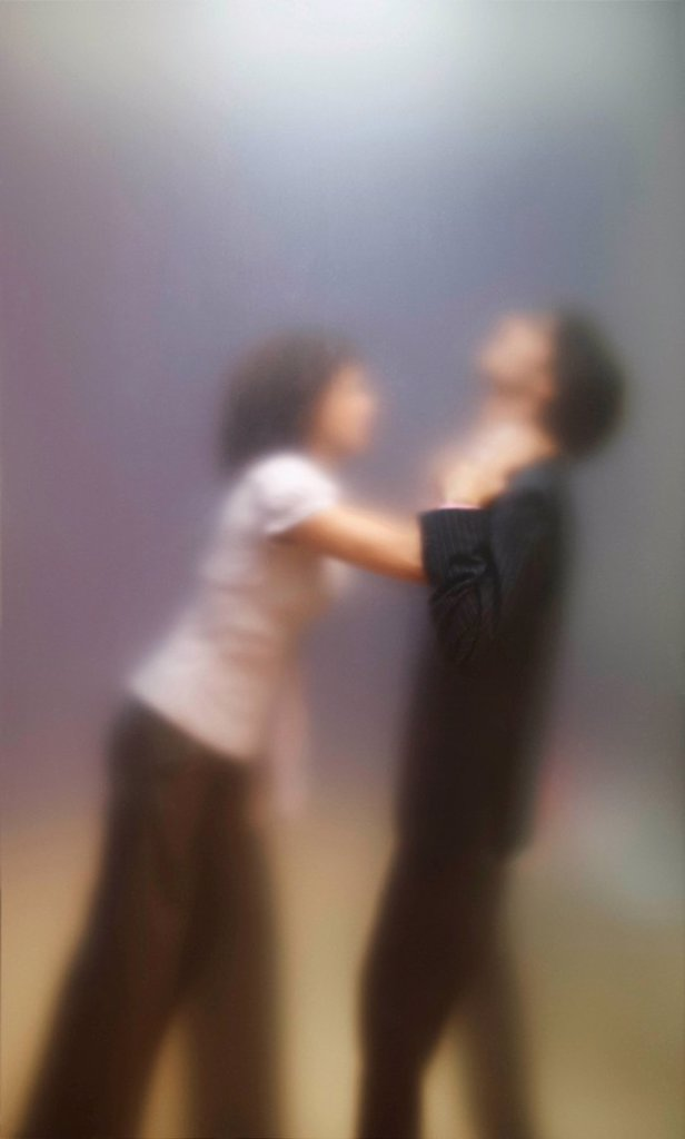 Stock Photo: 1773-20400 Blurred image of woman trying to strangle male co_worker. Seen through frosted office screen.