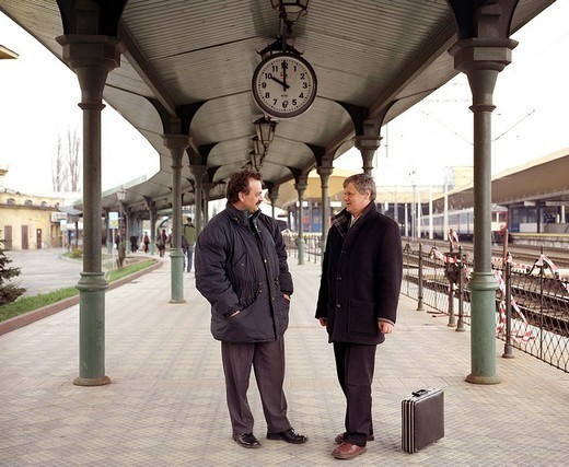 Two men talking on train platform : Stock Photo
