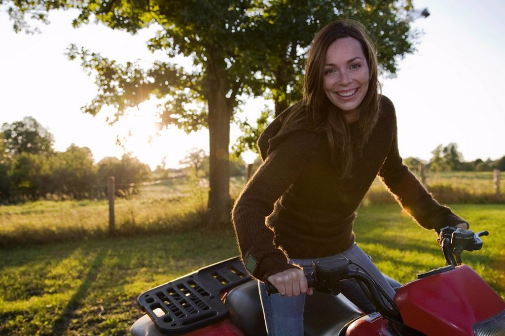 Woman on four wheeler : Stock Photo