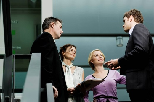 Business partners discussing a file : Stock Photo
