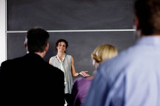Woman doing her business presentation : Stock Photo