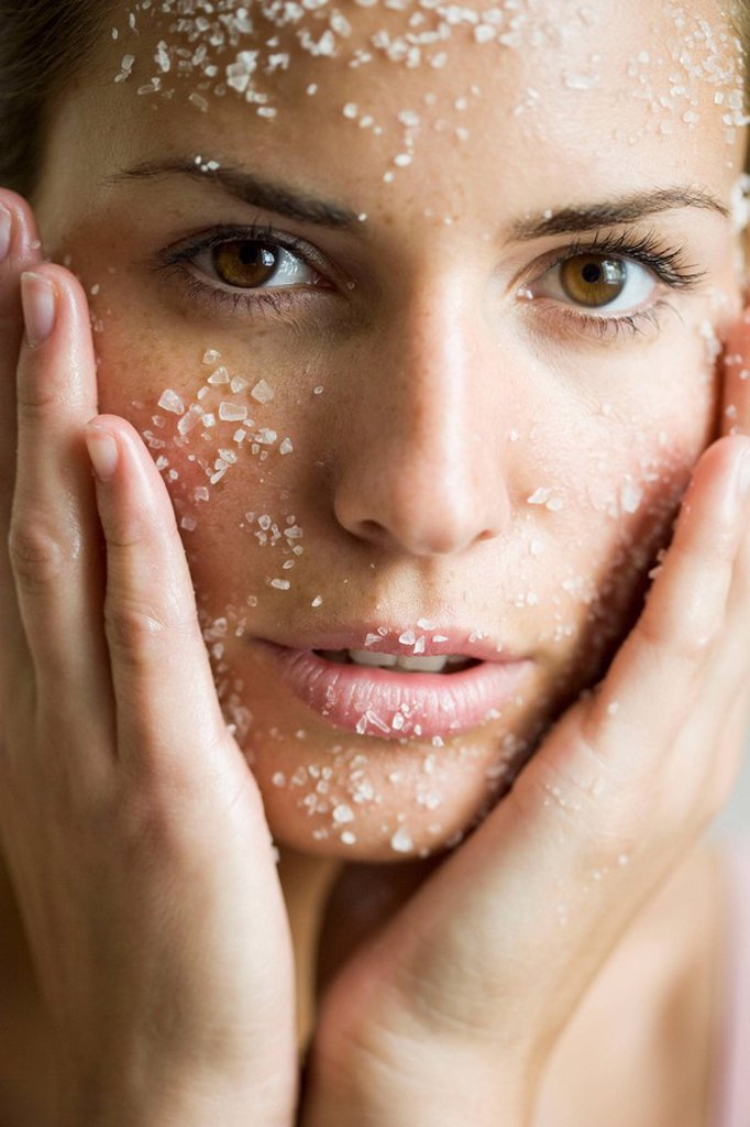 young woman with salt_peeling_mask : Stock Photo
