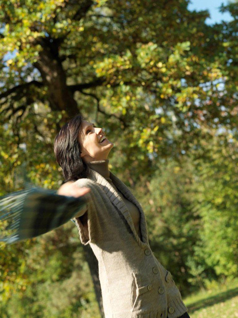 Stock Photo: 1773-24832 Woman enjoying an Autumn walk