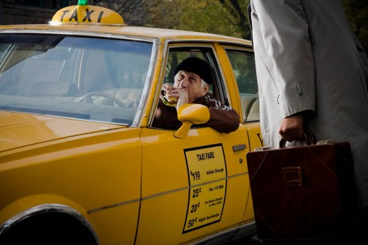 Taxi Driver interrupted during a break : Stock Photo