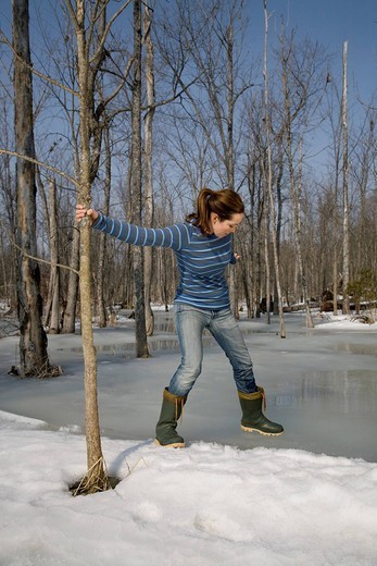 Woman Testing Ice on Pond : Stock Photo
