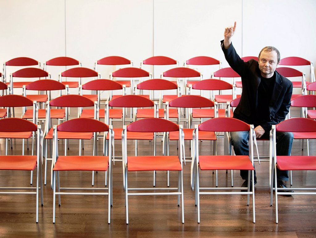 businessman alone raising hand : Stock Photo