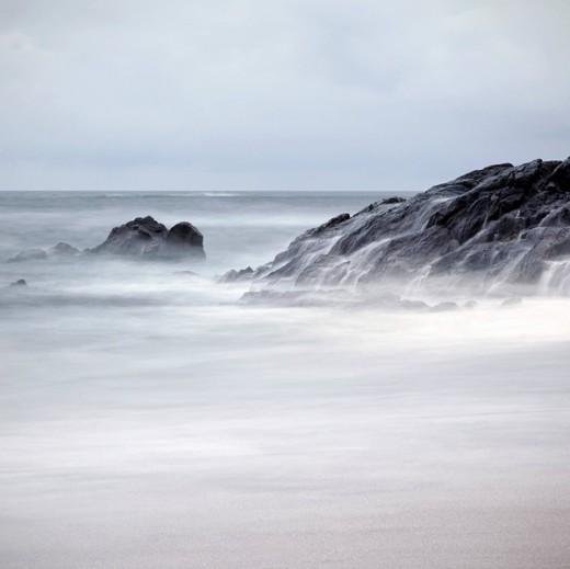 Rocky coastline at dusk : Stock Photo