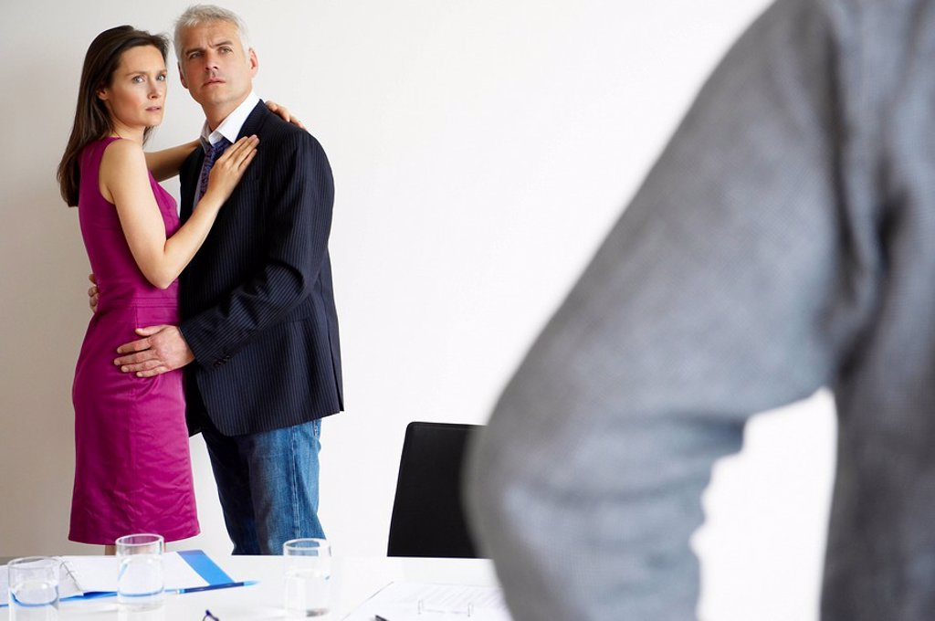 Couple caught at the office : Stock Photo