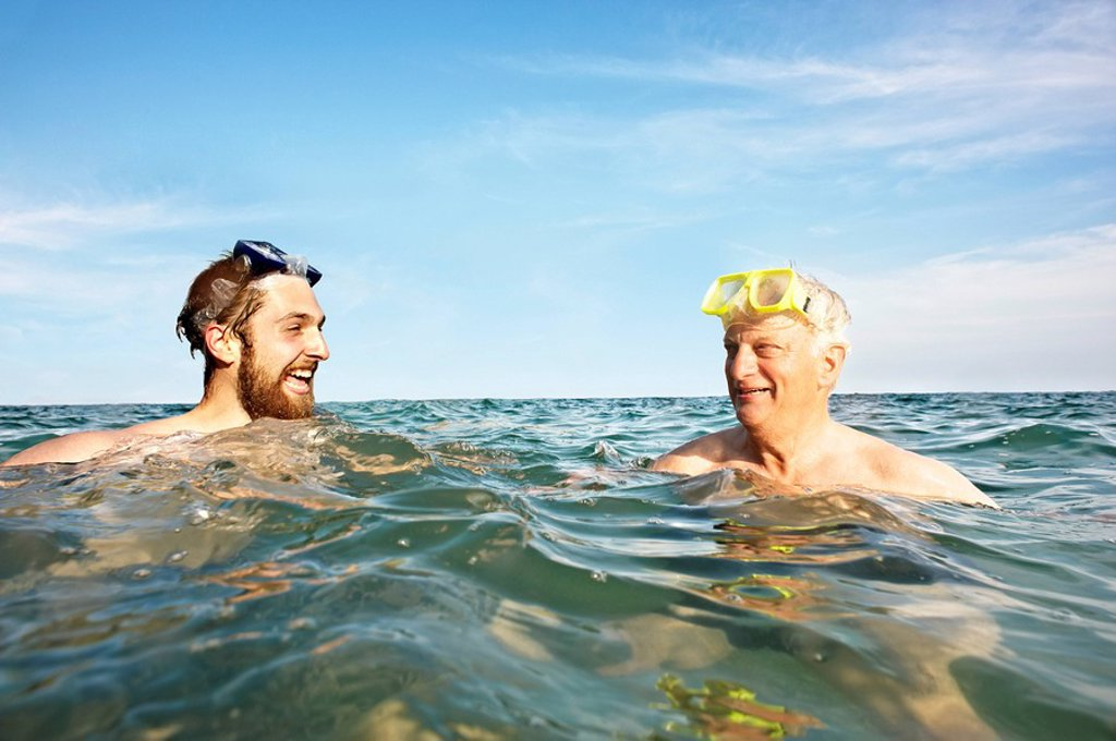 Portrait of two men swimming in sea : Stock Photo