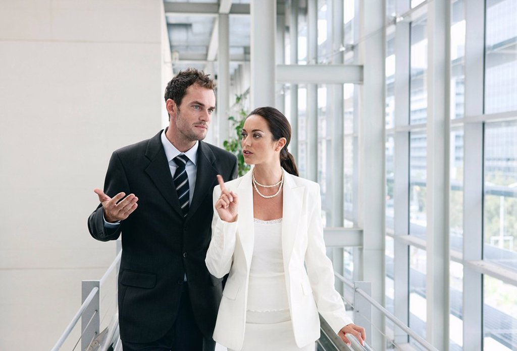 Business couple in corridor : Stock Photo