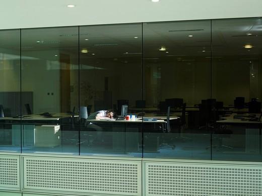 A man sleeps at his desk : Stock Photo