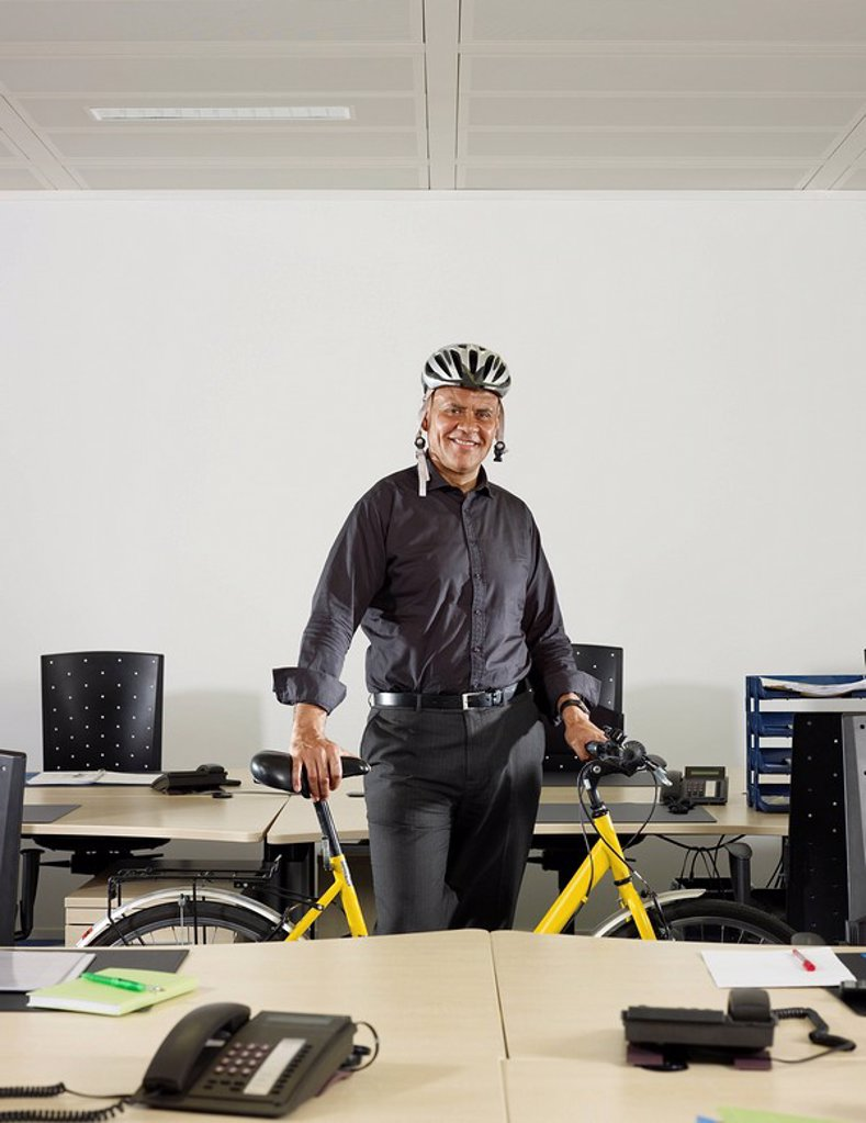 Stock Photo: 1773-27234 portrait of a man with a bicycle