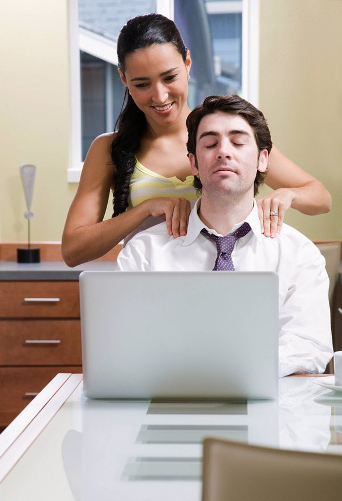 Stock Photo: 1773-27307 woman helping man relax at computer