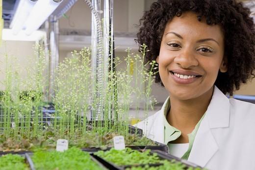 Female scientist smiling : Stock Photo