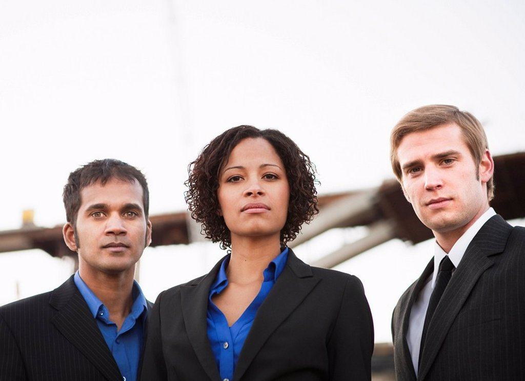 Stock Photo: 1773-27991 2 men and 1 woman in suits on worksite